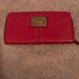 Uses Nicole Miller red wallet